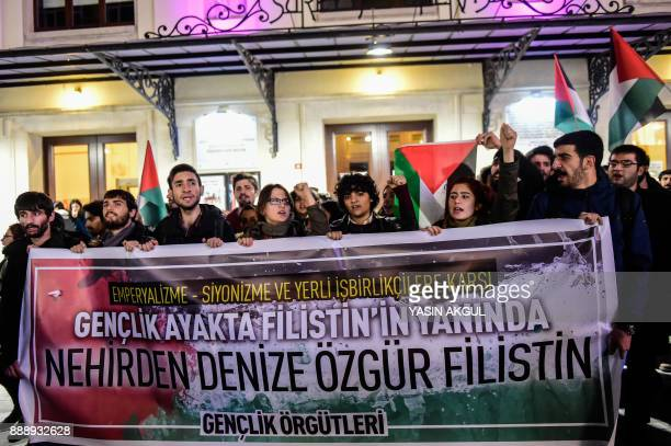 Leftist protesters hold a banner reading 'Against Imperialism Zionism and their domestic partners the Youth is standing up besides Palestine Free...