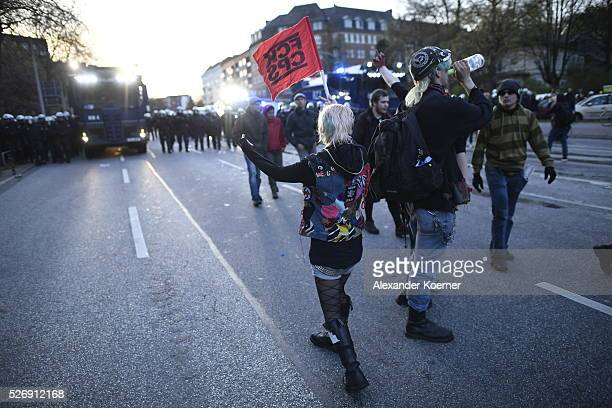 Leftist protesters march on May Day after clashing with police forces on 01 May 2016 in Hamburg Germany Tens of thousands of people across Germany...
