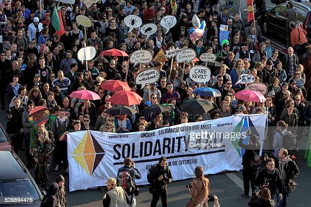 Leftist protesters march on May Day on May 1 2016 in Berlin Germany Tens of thousands of people across Germany participated in marches and gatherings...