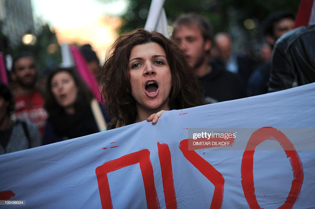 Leftist protesters shout anti-government slogans during their march in central Athens on May 3, 2010.
