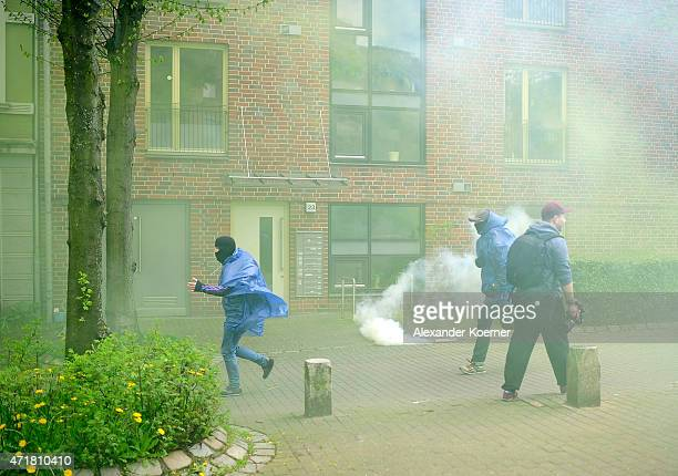 Leftist protestors run from riot police during annual May Day demonstrations on May 1 2015 in Hamburg Germany In Germany May Day traditionally brings...