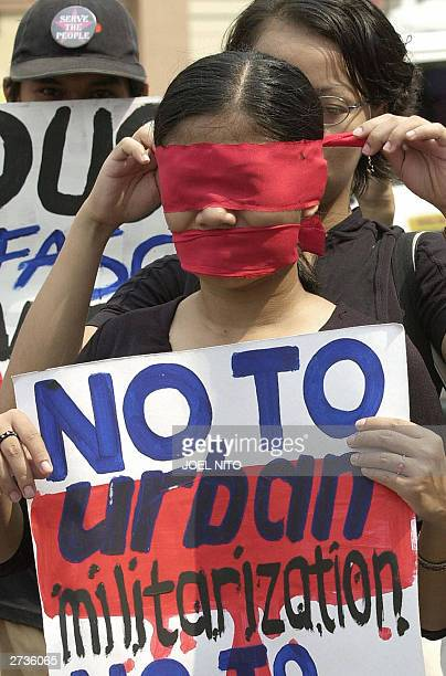 Leftist students blindfold themselves as they stage a demonstration calling for the ouster of Philippine President Gloria Arroyo in Manila 17...
