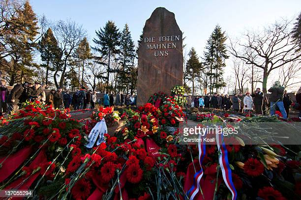 Leftist sympathizers lay carnations at a memorial to 1920sera assassinated German communists Rosa Luxemburg and Karl Liebknecht during an annual...