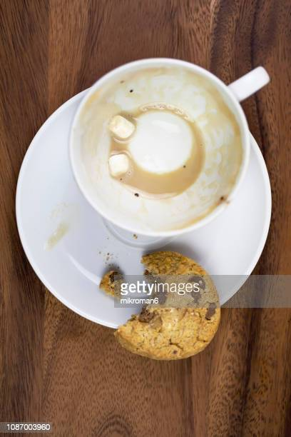 Leftovers In Coffee Cup with Biscuit