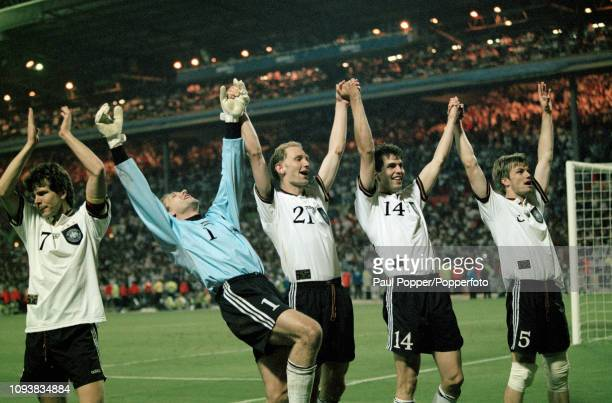 Leftright Andreas Moller Andreas Kopke Dieter Eilts Markus Babbel and Thomas Helmer of Germany celebrate after the UEFA Euro 1996 Final between Czech...
