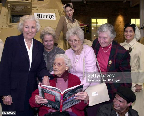 Dame Vera Lynn Jennie Harrison Mary Haines Ann Garlick and student Heidi Richards wearing a Munitions factory outfit with Janet Jackman seated * She...