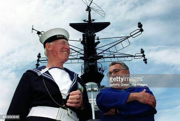 HMS Cavalier tour guide Archie McLaughlin and volunteer Ken Waddington in front of the destroyer at the Historic Dockyard Chatham Kent The last...