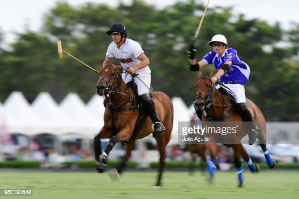 [LeftRight] Mariano Obregon of The Daily Racing Form and Tommy Beresford of Valiente race down the field in the US Open Polo Championship April 22...