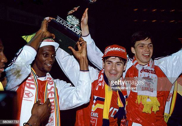Leftright Paul Davis Anders Limpar and David Hillier of Arsenal celebrate after their victory in the Barclays League Division One match against...