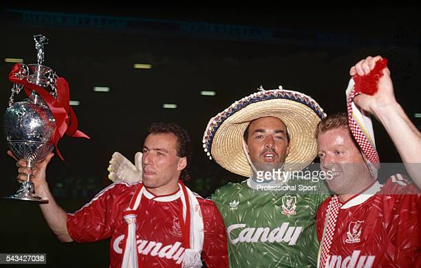 Leftright Ronny Rosenthal Bruce Grobbelaar and Steve Nicol of Liverpool celebrate with the League Championship trophy as Liverpool clinch the title...