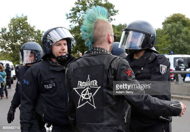 A leftwing activist argues with police officers during a march of NeoNazis at an extreme rightwing demonstration commemorating the 30th anniversary...
