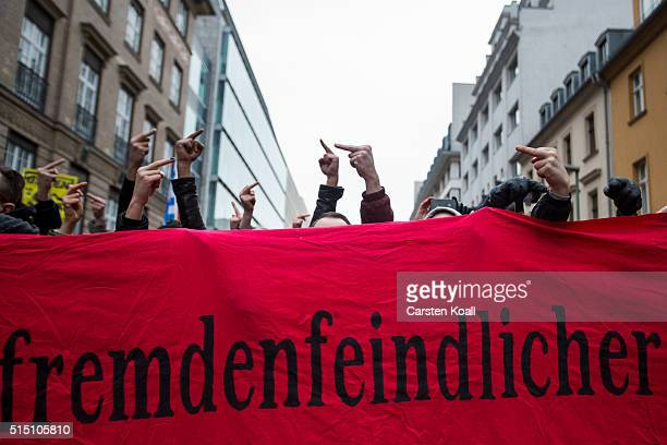 Leftwing activist protest against a rightwing march against the German Chancellor Angela Merkel in the city center on March 12 2016 Berlin Germany...