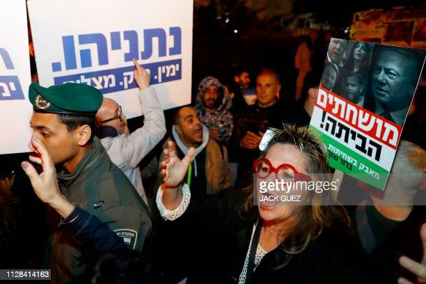 Leftwing and rightwing demonstrators are separated by police during a rally in support and against the Israeli Prime Minister Benjamin Netanyahu in...