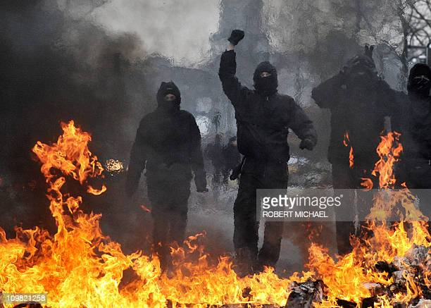 Leftwing counter demonstrators stand behind a burning blockade as riots broke out on the sidelines of a demonstrations against a neonazi rally in...
