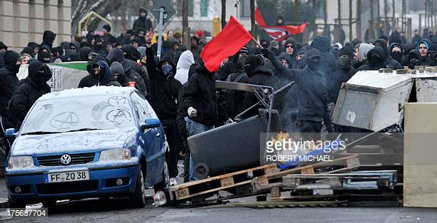 Left-wing counter demonstrators stand behind a street blokade against a neo-nazi rally in Dresden, eastern Germany on February 13, 2011. More than...