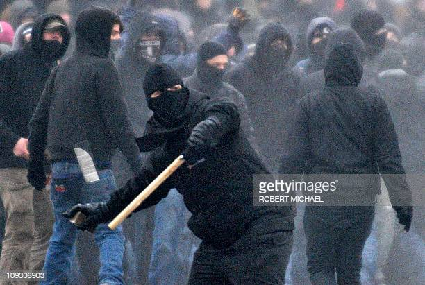 Left-wing counter demonstrators throw stones during a blokade against a neo-nazi rally in Dresden, eastern Germany on February 19, 2011. More than...