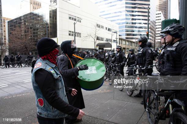 Leftwing counterdemonstrators and antifascist groups protest at a gun rights rally hosted by the right wing group the Washington State Three Percent...