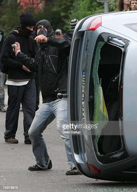 Left-wing demonstrators throw rocks and other objects at police during anti-G8 protests that turned violent June 2, 2007 in Rostock, Germany. Tens of...