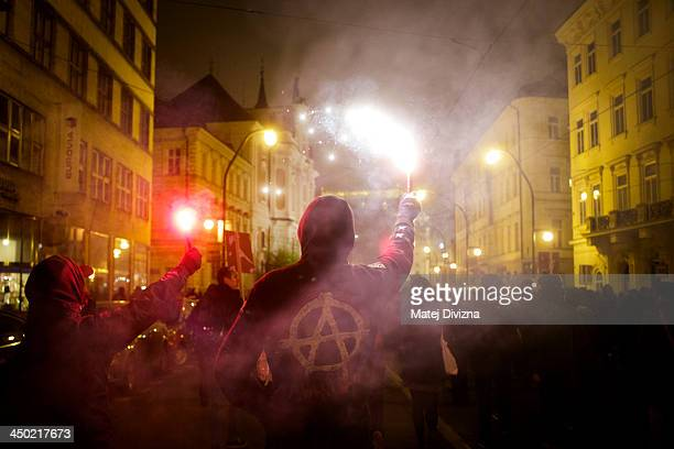 Leftwing extremists march as they hold flares during the 24th Anniversary Of The Velvet Revolution at Narodni street on November 17 2013 in Prague...