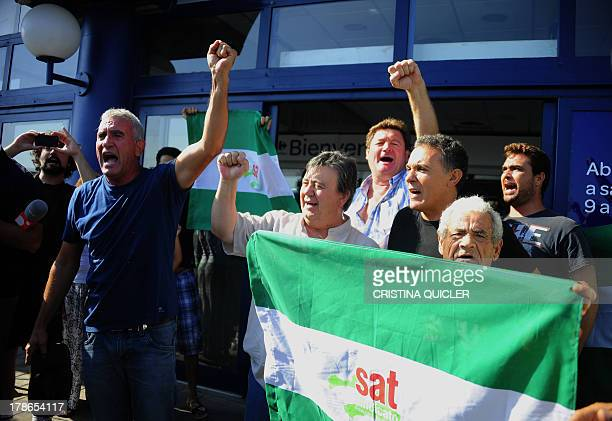 Leftwing group Sindicato Andaluz de Trabajadores spokesman Diego Canamero protests outide a supermarket during a Robin Hood like action where...