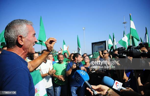 Leftwing group Sindicato Andaluz de Trabajadores spokesman Diego Canamero speaks to the media during a protests outide a supermarket during a Robin...
