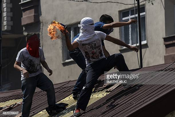 Left-wing militant prepares to throw a Molotov cocktail during clashes with Turkish riot police in Istanbul's Gazi district, on July 26, 2015....