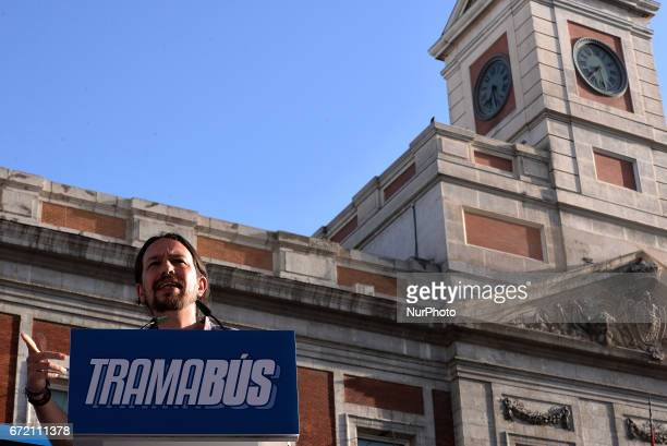 Leftwing party Podemos leader Pablo Iglesias speaks as the 'Tramabus' an anticorruption bus belonging to the Spanish opposition party Podemos makes a...