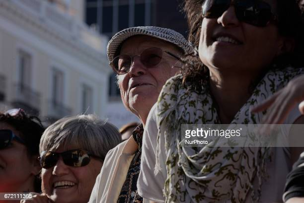 Leftwing party Podemos members attend an anticorruption bus belonging to the Spanish opposition party Podemos makes a stop at Puerta del Sol in...