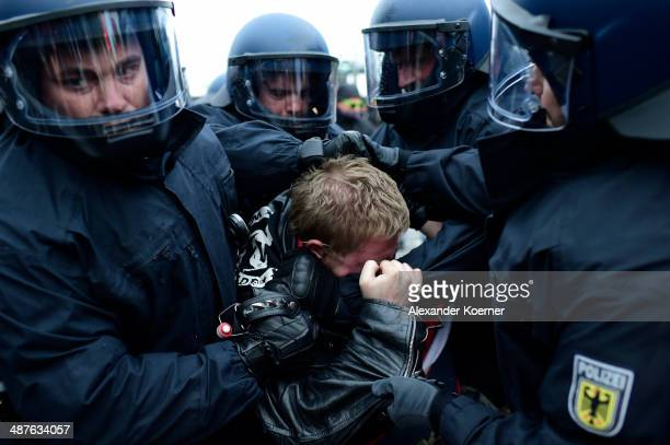 Left-wing protester clashes with police on May 1, 2014 in Hamburg, Germany. Left-wing activists from across Germany gathered in Hamburg today to take...