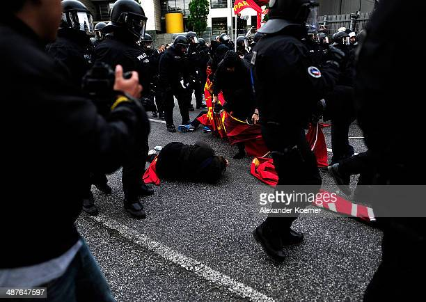 Leftwing protester lies injured on the street after clashing with police forces on May 1 2014 in Hamburg Germany Leftwing activists from across...