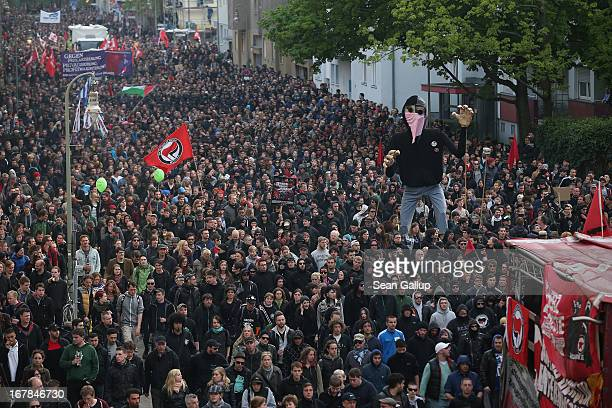 "Left-wing protesters carry a giant puppet as they march in the annual ""Revolutionaerer 1. Mai"" demonstration on May Day on May 1, 2103 in Berlin,..."