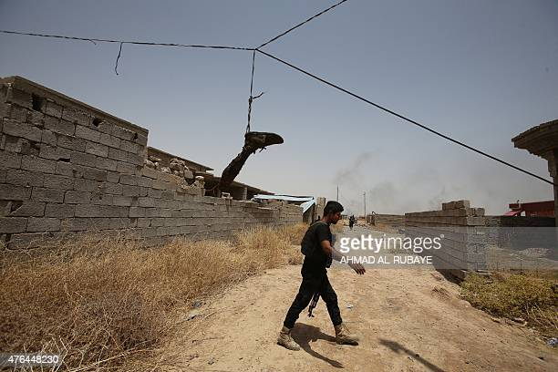 A leg allegedly belonging to a jihadist of the Islamic State group is seen hanging in the Iraqi town of Baiji north of Tikrit after it was found...