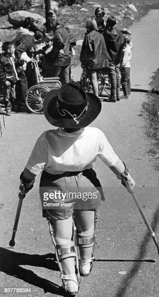 Leg braces and crutches become invisible at the Easter Seal Handicamp near Georgetown Colo when physically handicapped youngsters romp in fresh air...