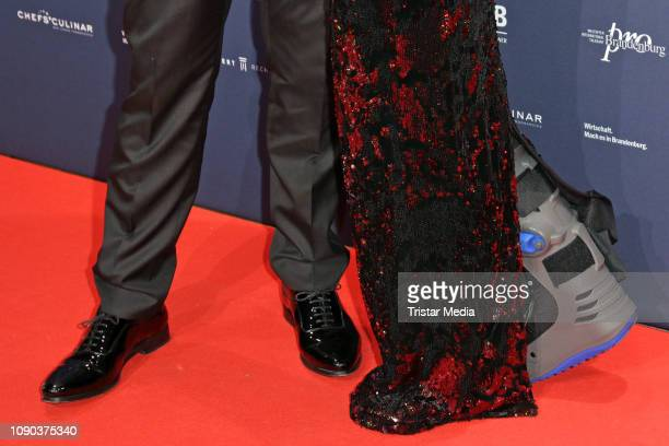 Leg in plaster of HAlice Krueger wife of Hardy Kruger Jr as a detail during the Brandenburgball on January 26 2019 in Potsdam Germany