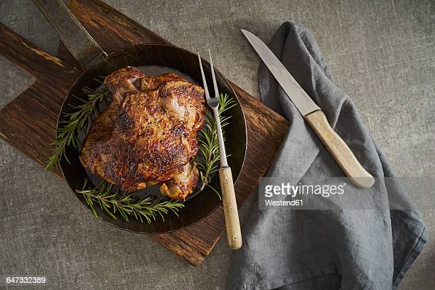 Leg of lamb with rosemary, frying pan