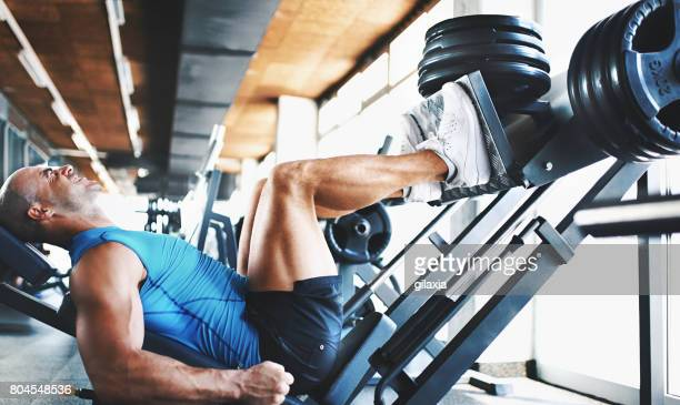 leg press exercise. - human leg stock pictures, royalty-free photos & images