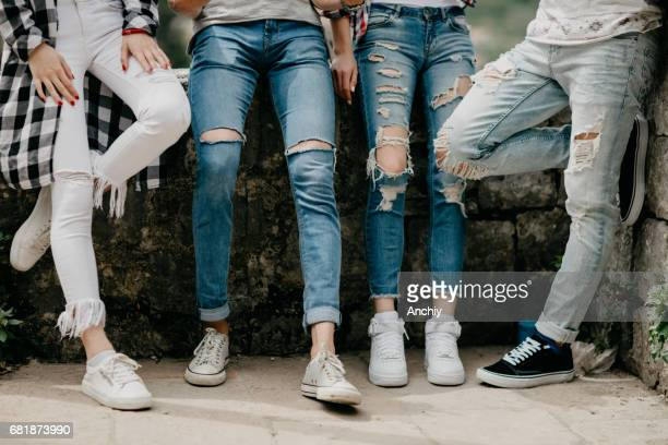 leg shot of four friends - jeans stock pictures, royalty-free photos & images