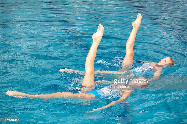 leg symmetry of synchronized swimming girls - artistic swimming stock pictures, royalty-free photos & images