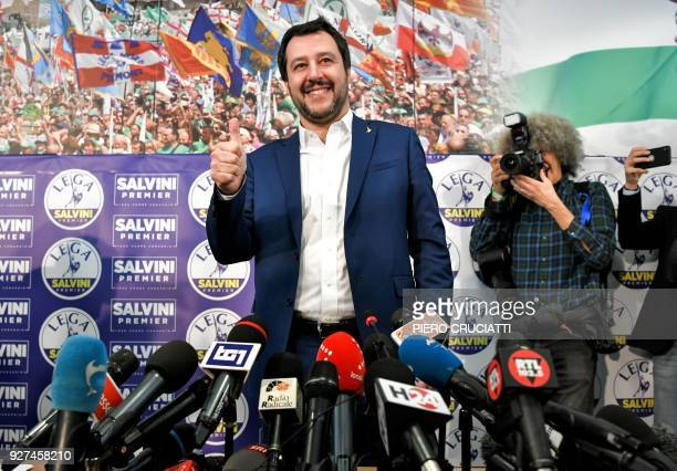 Lega far right party leader Matteo Salvini puts a thumb up as he arrives at the Lega headquarter in Milan on March 5 2018 for a press conference...