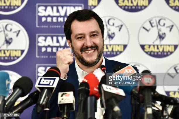 Lega far right party leader Matteo Salvini smiles and rises his fist at the Lega headquarter in Milan on March 5 2018 for a press conference ahead of...
