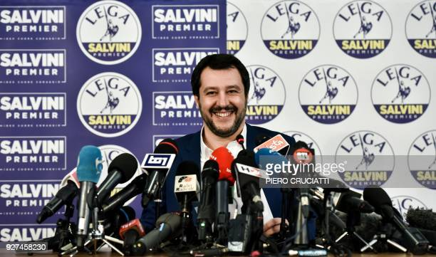 Lega far right party leader Matteo Salvini smiles at the Lega headquarter in Milan on March 5 2018 during a press conference ahead of the Italy's...