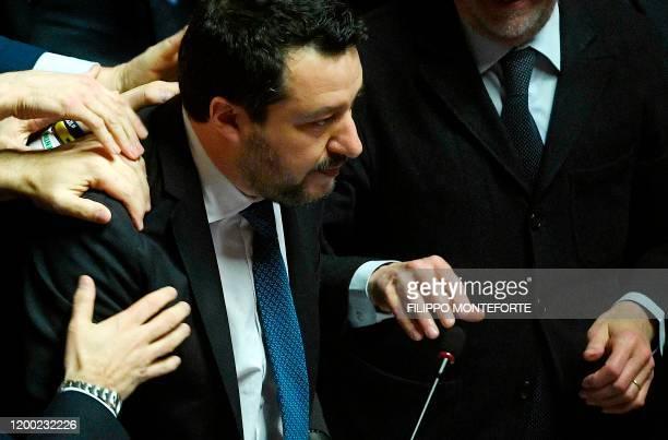 Lega members congratulate Italian Lega party farright leader Matteo Salvini after he addressed the Senate on February 12 2020 in Rome as Italian...