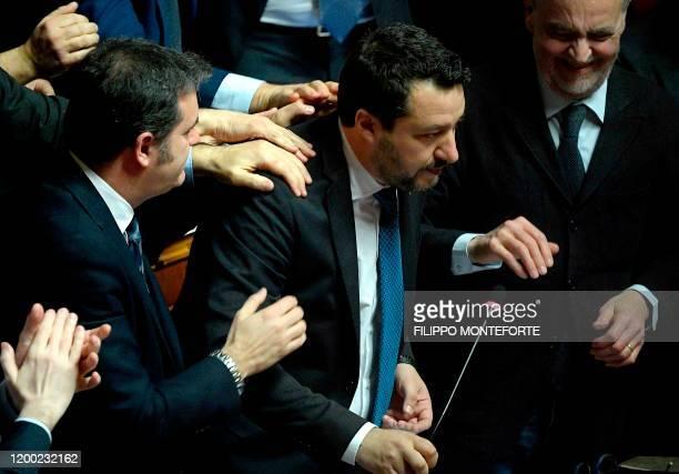 Lega members Gian Marco Centinaio and Roberto Calderoli congratulate Italian Lega party far-right leader Matteo Salvini after he addressed the Senate...