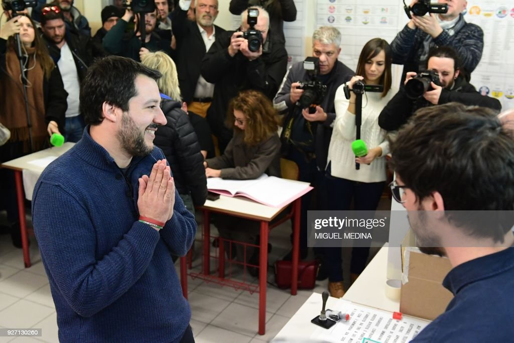 TOPSHOT - Lega Nord far right party leader Matteo Salvini gestures as he votes for general elections on March 4, 2018 at a polling station in Milan. Italians vote today in one of the country's most uncertain elections, with far-right and populist parties expected to make major gains. / AFP PHOTO / Miguel MEDINA