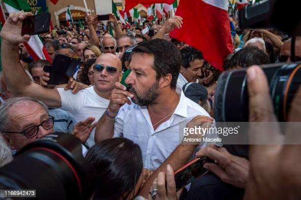 Lega political party leader Matteo Salvini kisses his rosary during a national demonstration organized by Fratelli d'Italia political party during...