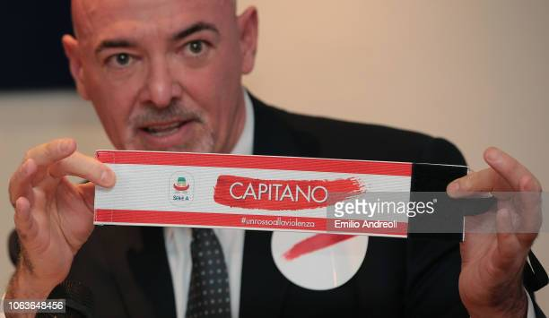 Lega Serie A CEO Marco Brunelli shows the official captain bandage during the Lega Serie A 'Un Rosso Alla Violenza' press conference on November 20,...