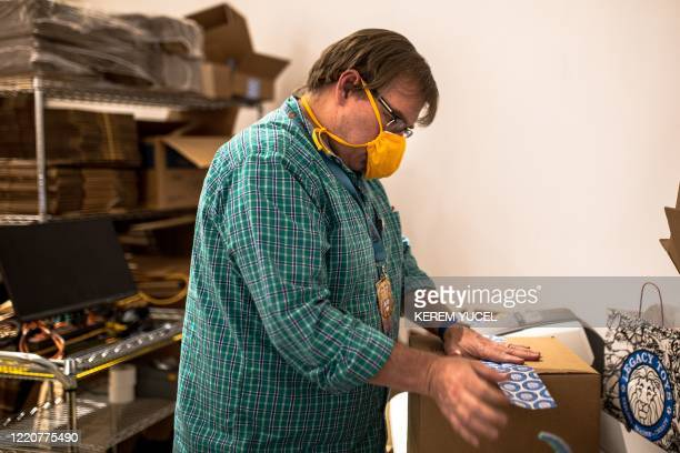 Legacy Toys Store Manager Jeff Kasper prepares a box for shipment at the store in the Mall of America on June 16 2020 in Bloomington Minnesota The US...