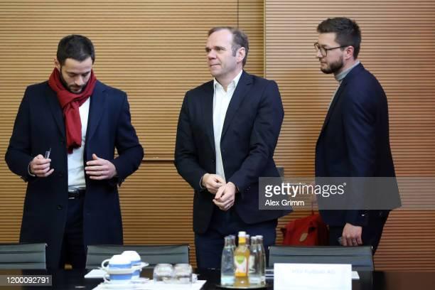 Legal adviser Dr. Philipp Goebel, CEO Bernd Hoffmann, fan liaison officer Cornelius Goebel of Hamburger SV wait for the start of a DFB Sports Court...