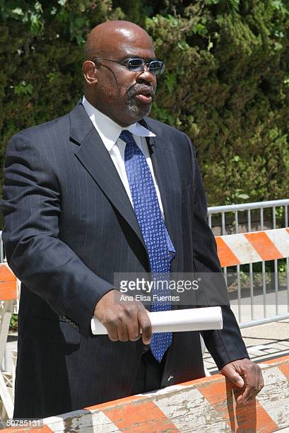 Legal Analyst Christopher Darden chats with members of the news media about media placement on April 29 2004 in Santa Maria California New fences and...