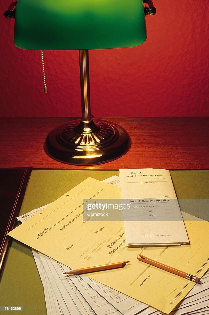 Legal documents on desk with lamp and broken pencil : Stockfoto